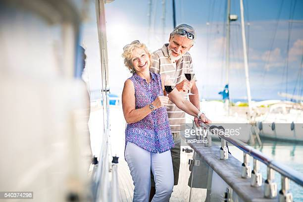 Retired couple having a weekend together on a yacht