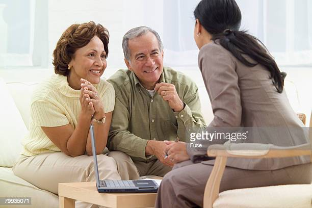 Retired Couple Meeting with Businesswoman