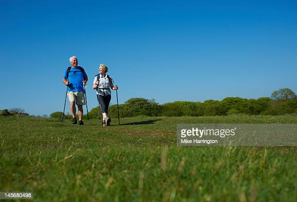 Retired Couple Nordic Walking in Countryside