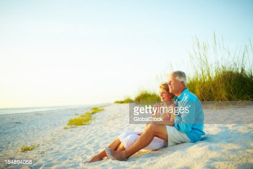 Retired couple sharing a moment on the beach