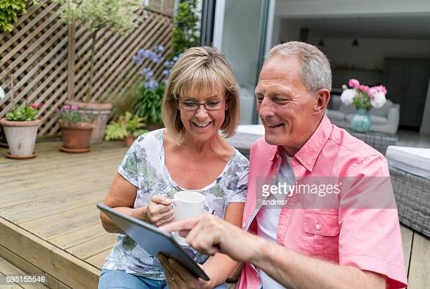 Retired couple using technology at home
