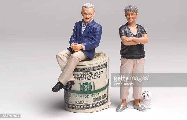 Retired couple with dollar bank notes