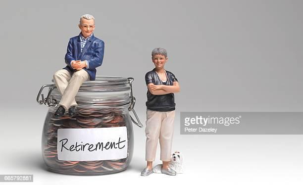 Retired couple with retirement savings jar