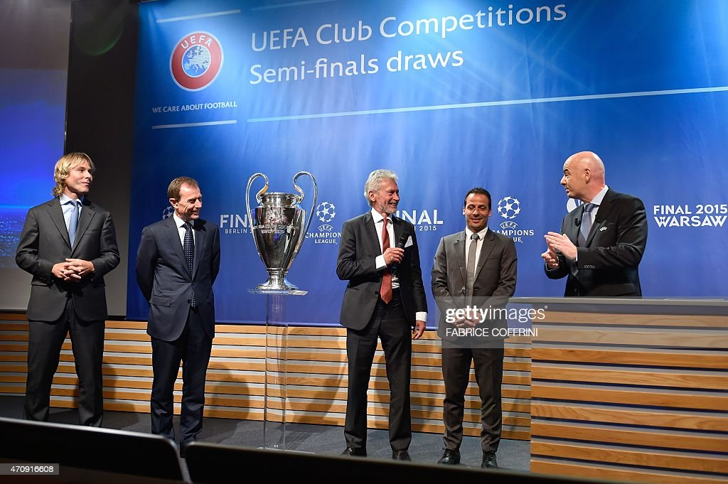 Retired Czech football midfielder, ambassador for the 2015 UEFA European Under-21 Championship, and Juventus representative <a gi-track='captionPersonalityLinkClicked' href=/galleries/search?phrase=Pavel+Nedved&family=editorial&specificpeople=211256 ng-click='$event.stopPropagation()'>Pavel Nedved</a>, retired player and current Real Madrid's Director of International Relations, <a gi-track='captionPersonalityLinkClicked' href=/galleries/search?phrase=Emilio+Butragueno&family=editorial&specificpeople=746497 ng-click='$event.stopPropagation()'>Emilio Butragueno</a>, former players Germany's <a gi-track='captionPersonalityLinkClicked' href=/galleries/search?phrase=Paul+Breitner&family=editorial&specificpeople=746492 ng-click='$event.stopPropagation()'>Paul Breitner</a>, representing Bayern Munich and France's <a gi-track='captionPersonalityLinkClicked' href=/galleries/search?phrase=Ludovic+Giuly&family=editorial&specificpeople=238873 ng-click='$event.stopPropagation()'>Ludovic Giuly</a>, representing Barcelona, and UEFA secretary general Gianni Infantino react on stage after the draw for the UEFA Champions League semi-final football matches at the UEFA headquarters in Nyon on April 24, 2015.