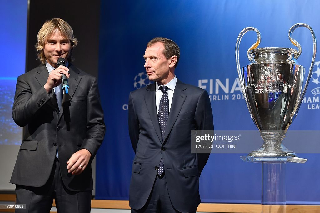 Retired Czech football midfielder, ambassador for the 2015 UEFA European Under-21 Championship, and Juventus representative <a gi-track='captionPersonalityLinkClicked' href=/galleries/search?phrase=Pavel+Nedved&family=editorial&specificpeople=211256 ng-click='$event.stopPropagation()'>Pavel Nedved</a> (L), and retired player and current Real Madrid's Director of International Relations, <a gi-track='captionPersonalityLinkClicked' href=/galleries/search?phrase=Emilio+Butragueno&family=editorial&specificpeople=746497 ng-click='$event.stopPropagation()'>Emilio Butragueno</a>, react on stage by the UEFA Champions League trophy after the draw for the UEFA Champions League semi-final football matches at the UEFA headquarters in Nyon on April 24, 2015.