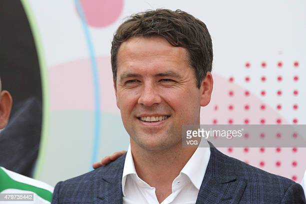 Retired English footballer Michael Owen visits a primary school on July 6 2015 in Beijing China