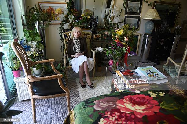 Retired film researcher Lillian Michelson poses in her room at the Motion Picture Television Fund Country House a retirement community for members of...