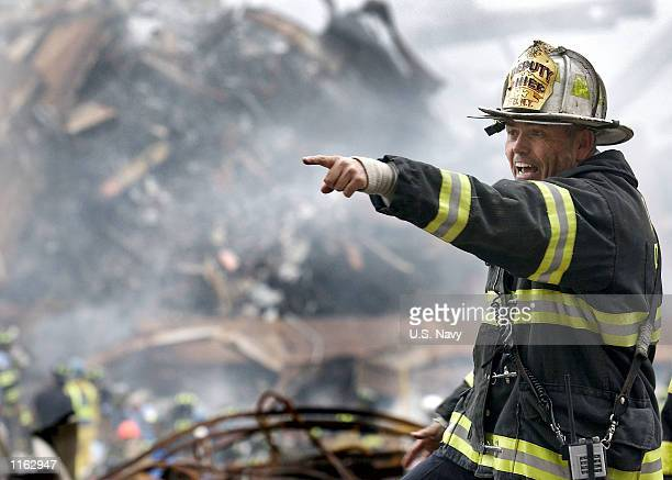 Retired Fire Chief Joseph Curry barks orders to rescue teams as they clear through debris that was once the World Trade Center September 14 2001 in...