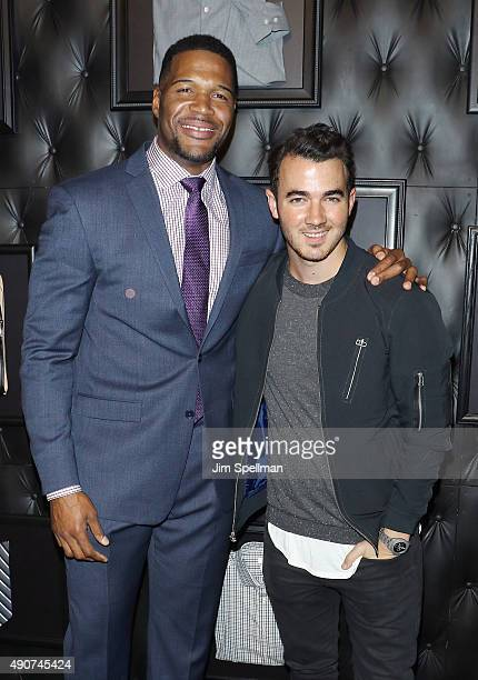 Retired football player/TV personality Michael Strahan and singer Kevin Jonas attend the JCPenney x Michael Strahan launch party at JCPenney on...