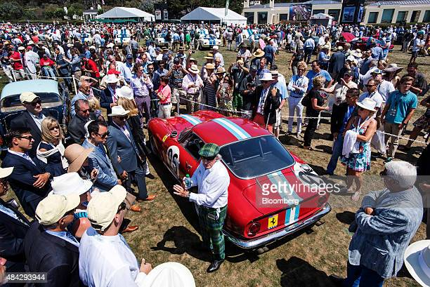 Retired Formula One race car driver Jackie Stewart foreground center speaks to attendees during the 2015 Pebble Beach Concours d'Elegance in Pebble...