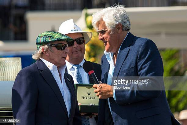 Retired Formula One race car driver Jackie Stewart left speaks with entertainer Jay Leno right during a prize presentation during the 2015 Pebble...