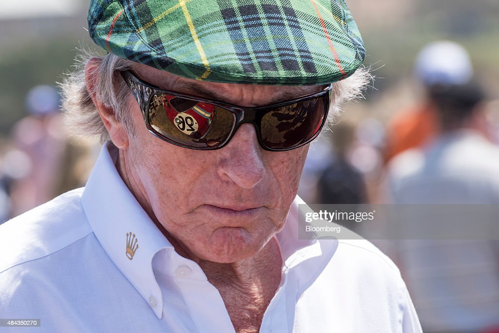 Retired Formula One race car driver <a gi-track='captionPersonalityLinkClicked' href=/galleries/search?phrase=Jackie+Stewart+-+Race+Car+Driver&family=editorial&specificpeople=167276 ng-click='$event.stopPropagation()'>Jackie Stewart</a> speaks to a group during the 2015 Pebble Beach Concours d'Elegance in Pebble Beach, California, U.S., on Sunday, Aug. 16, 2015. Of the top 10 high-selling cars sold in the days surrounding the annual car show, seven were Ferraris. All told, auction houses lead by Gooding, RM Sotheby's, Bonhams, and Mecum Auction took in$390.6 million dollars, according to early estimates by Hagerty, a Traverse City (Mich.)insurer and classic car database. Photographer: David Paul Morris/Bloomberg via Getty Images