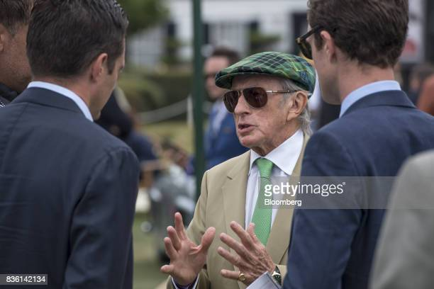 Retired Formula One race car driver Jackie Stewart speaks with attendees during the 2017 Pebble Beach Concours d'Elegance in Pebble Beach California...