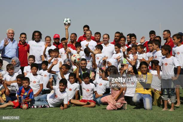 Retired French football Christian Karembeu UEFA President Aleksander Ceferin and Jordan's Prince Ali bin alHussein pose for a family picture with...