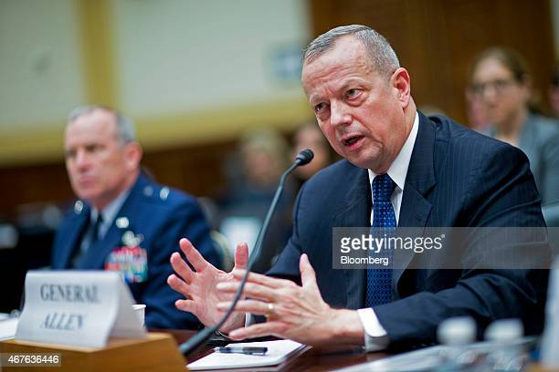Retired General John Allen the special presidential envoy for the global coalition against Islamic State right speaks during a House Foreign Affairs...