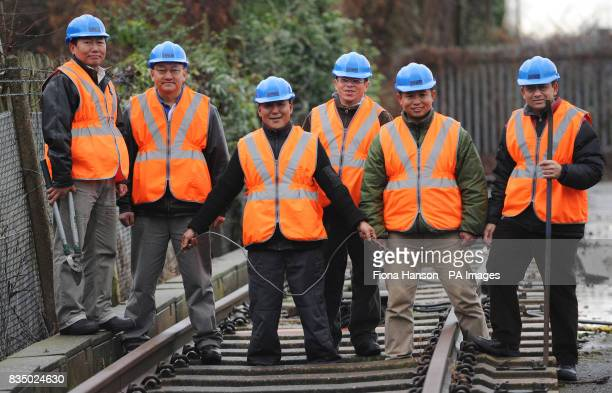 Retired Ghurkha engineers at Clapham Junction London who are part of a pioneering scheme to recruit and retrain as railway engineers for Network Rail
