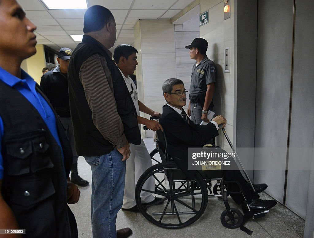 Retired Guatemalan General, Jose Rodriguez, arrives in court for the opening of the trial on charges of genocide against him along with former Guatemalan de facto President (1982-1983), retired General Jose Efrain Rios Montt (out of frame), during the latter's de facto 1982-83 regime, in Guatemala City on March 19, 2013. Rios Montt, who stands trial despite defense attempts to postpone the start of the historic proceedings, is accused of ordering the execution of 1,771 members of the indigenous Ixil Maya people in the Quiche region. The trial marks the first time genocide proceedings have been brought in relation to the 36-year civil war in Guatemala that ended in 1996, leaving an estimated 200,000 people dead, according to United Nations estimates. AFP PHOTO/Johan ORDONEZ