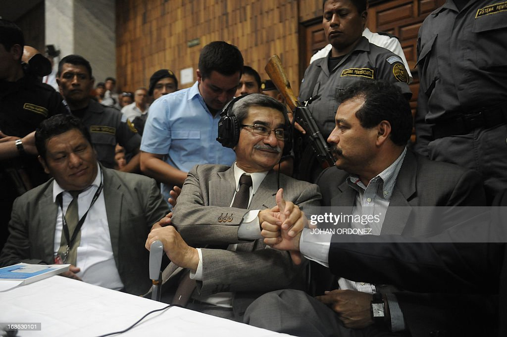 Retired Guatemalan General Jose Rodriguez (C), former intelligence chief of former Guatemalan de facto President (1982-1983), retired General Jose Efrain Rios Montt, react after being absolved of charges of genocide committed during the de facto regime, in Guatemala City, on May 10, 2013. Rios Montt was found guilty of genocide and war crimes on Friday in a landmark ruling stemming from massacres of indigenous people in his country's long civil war. Rios Montt thus became the first Latin American convicted of trying to exterminate an entire group of people in a brief but particularly gruesome stretch of a war that started in 1960, lasted 36 years and left around 200,000 people dead or missing. AFP PHOTO / Johan ORDONEZ