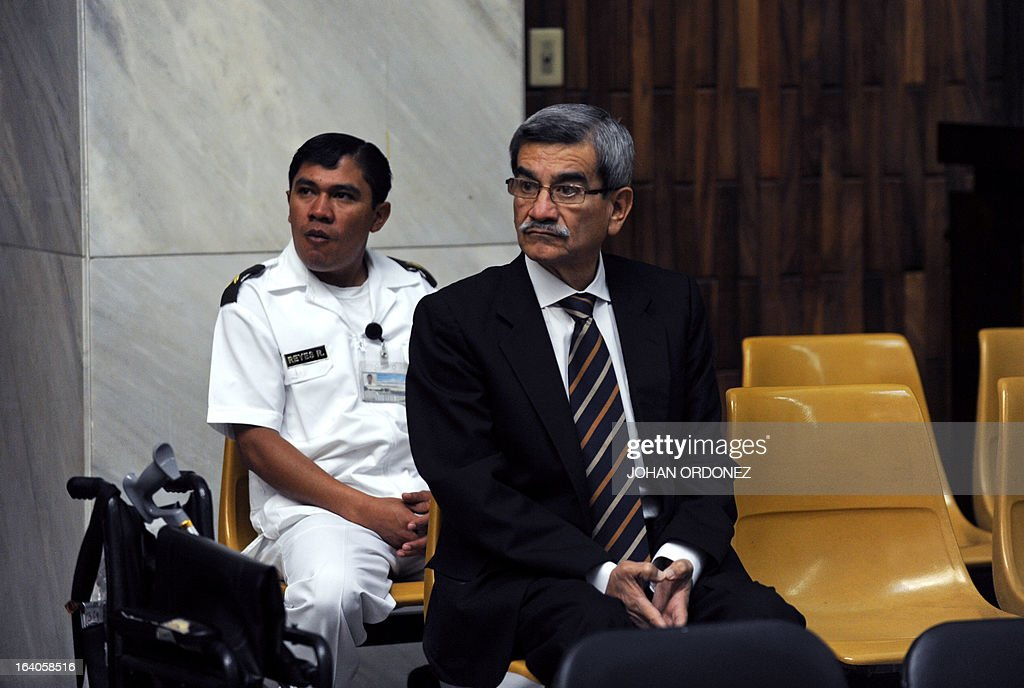 Retired Guatemalan General, Jose Rodriguez, reacts during the opening of the trial on charges of genocide against him along with former Guatemalan de facto President (1982-1983), retired General Jose Efrain Rios Montt (out of frame), during the latter's de facto 1982-83 regime, in Guatemala City on March 19, 2013. Rios Montt, who stands trial despite defense attempts to postpone the start of the historic proceedings, is accused of ordering the execution of 1,771 members of the indigenous Ixil Maya people in the Quiche region. The trial marks the first time genocide proceedings have been brought in relation to the 36-year civil war in Guatemala that ended in 1996, leaving an estimated 200,000 people dead, according to United Nations estimates. AFP PHOTO/Johan ORDONEZ