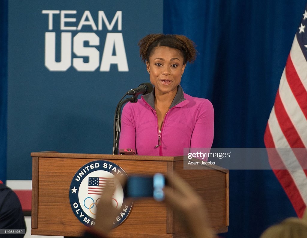 Retired gymnast Dominique Dawes introduces First Lady Michelle Obama at the University of East London on July 27, 2012 in London, England. Michelle Obama addressed members of the 2012 Team USA as leader of the US Olympics delegation, ahead of opening ceremony for the Olympics.