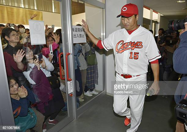 Retired Hiroshima Carp righthander Hiroki Kuroda waves to his fans after a press conference in the western Japan city of Hiroshima on Nov 4 2016...
