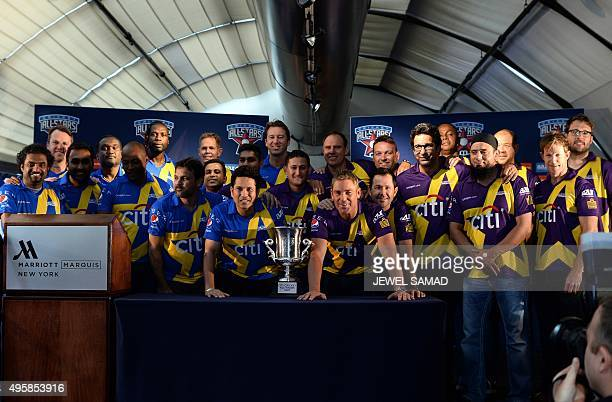 Retired Indian cricketer Sachin Tendulkar and Australian Shane Warne and their their teammates pose with the trophy during a press conference in New...
