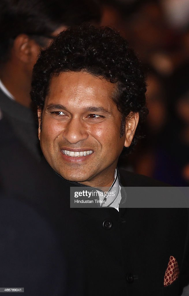 Retired Indian cricketer Sachin Tendulkar interacts with the guests before receiving the Bharat Ratna award by President Pranab Mukherjee at India's presidential palace Rashtrapati Bhavan on February 4, 2014 in New Delhi, India. Tendulkar, who was nominated to the Rajya Sabha last year, is the first sportsperson and the youngest recipient of India's highest civilian award.