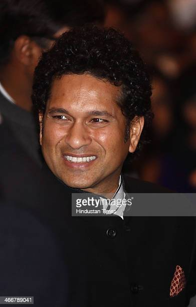 Retired Indian cricketer Sachin Tendulkar interacts with the guests before receiving the Bharat Ratna award by President Pranab Mukherjee at India's...
