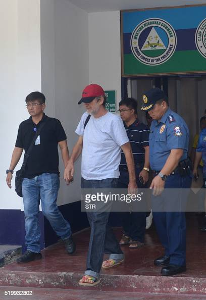 Retired Italian priest Rolando Del Torchio escorted by police leaves a military hosipital in Zamboanga City in southern island of Mindanao on April 9...