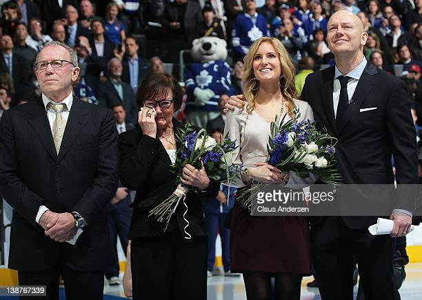 Retired Leaf legend Mats Sundin watches with his wife Josephine and his parents as his number is raised to the ceiling prior to a game between the...