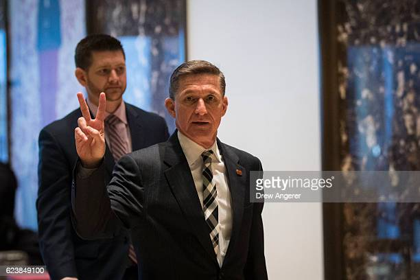 Retired Lt Gen Michael Flynn gestures as he arrives at Trump Tower November 17 2016 in New York City Presidentelect Donald Trump and his transition...