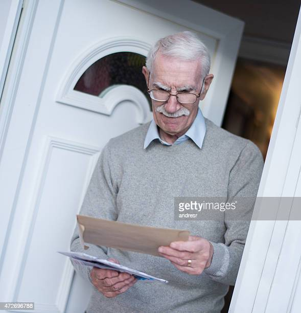 Retired man checking the mail