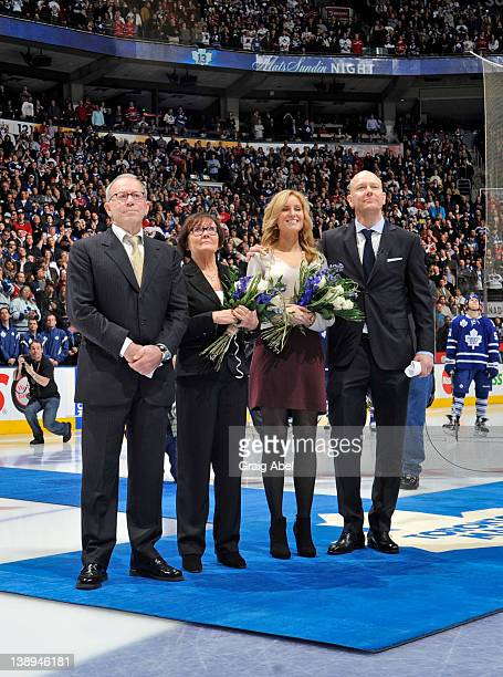 Retired Maple Leafs Captain Mats Sundin watches with his wife Josephine and his parents as his number is raised to the rafters prior to NHL game...