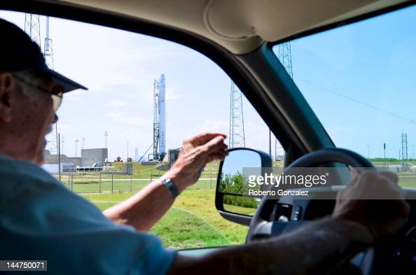 Retired NASA employee Charlie Parker passes the SpaceX rocket Falcon 9 which sits on Pad 40 of the Cape Canaveral Air Force Station in Titusville...