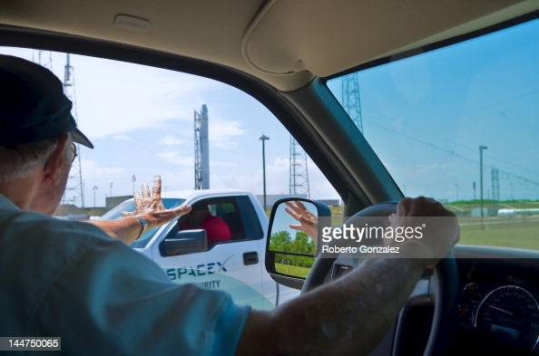 Retired NASA employee Charlie Parker waves to SpaceX security as the companies rocket Falcon 9 sits on Pad 40 of the Cape Canaveral Air Force Station...