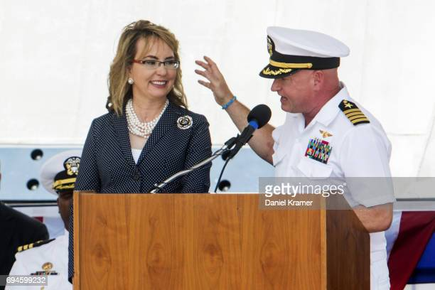 Retired Navy Captain Mark Kelly and his wife Gabrielle Giffords share the podium during the commissioning of the USS Gabrielle Giffords on June 10...