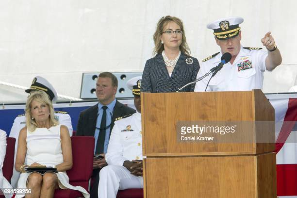 Retired Navy Captain Mark Kelly points to the crew of the USS Gabrielle Giffords during the commissioning ceremony on June 10 2017 in Galveston Texas...