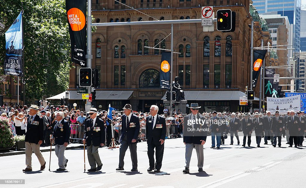 Retired Navy personnel are cheered on by the crowd as they march down George Street on October 9, 2013 in Sydney, Australia. Over 4,000 personnel paraded through the streets of Sydney just one day before the end of International Fleet Review in Sydney.