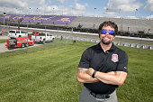 Retired Navy SEAL and Crown Royal 'Your Hero's Name Here' winner Jason Redman attends the Combat Wounded Coalition 400 presented by Crown Royal at...