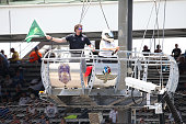 Retired Navy SEAL and Crown Royal 'Your Hero's Name Here' winner Jason Redman waves the green flag for qualifying for the Crown Royal Presents the...