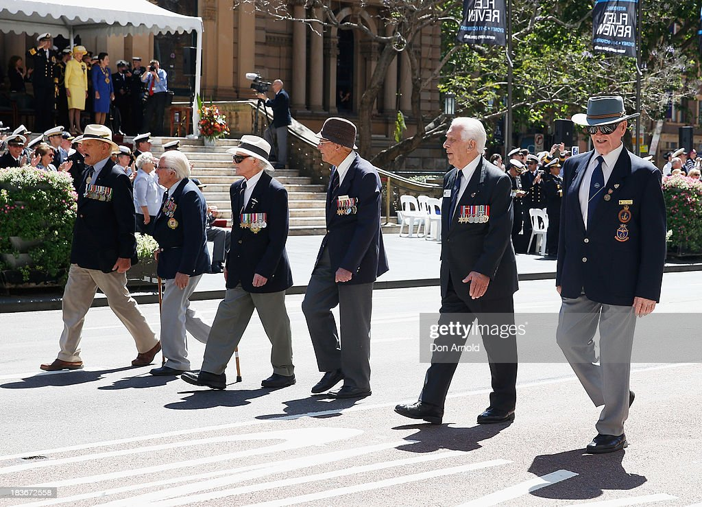 Retired Navy Servicemen parade past the Governor-General <a gi-track='captionPersonalityLinkClicked' href=/galleries/search?phrase=Quentin+Bryce&family=editorial&specificpeople=2602196 ng-click='$event.stopPropagation()'>Quentin Bryce</a> as they march down George St on October 9, 2013 in Sydney, Australia. Over 4,000 personnel paraded through the streets of Sydney just one day before the end of International Fleet Review in Sydney.