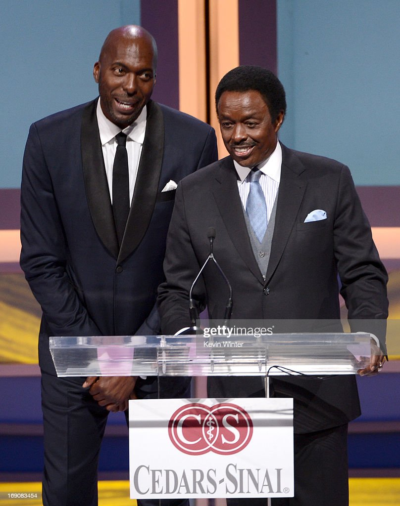 Retired NBA player and radio host John Salley and sportscaster Jim Hill speak onstage at the 28th Anniversary Sports Spectacular Gala at the Hyatt...