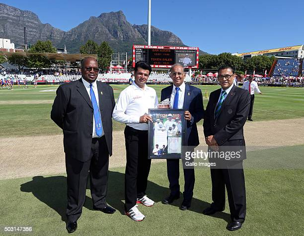 Retired Pakistani cricketer Aleem Dar receives an award for his 100th test during day 1 of the 2nd Test match between South Africa and England at PPC...