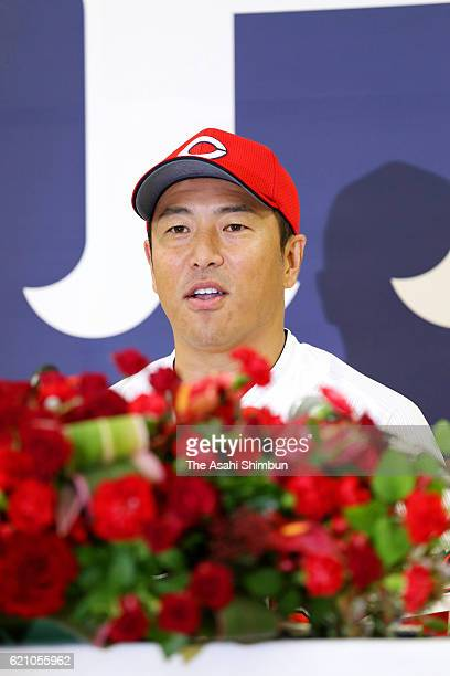 Retired pitcher Hiroki Kuroda of Hiroshima Carp speaks during a press conference on November 4 2016 in Hiroshima Japan