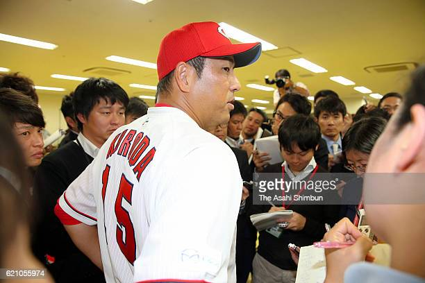 Retired pitcher Hiroki Kuroda of Hiroshima Carp speaks to media reporters after a press conference on November 4 2016 in Hiroshima Japan