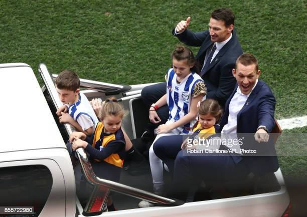 Retired players Drew Petrie and Brent Harvey wave to the crowd during the 2017 AFL Grand Final match between the Adelaide Crows and the Richmond...