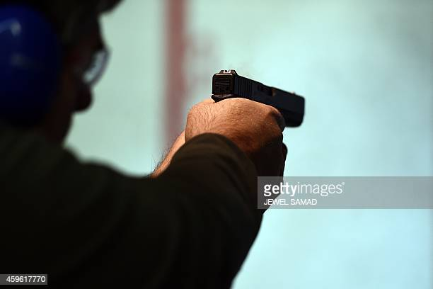 Retired police officer Jeff fires a gun at the Ultimate Defense Firing Range and Training Center in St Peters Missouri some 20 miles west of Ferguson...