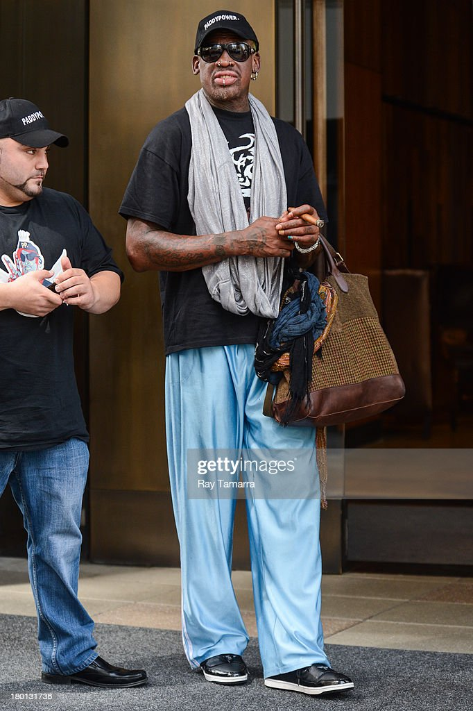 Retired professional basketball player Dennis Rodman leaves his Soho hotel on September 9, 2013 in New York City.