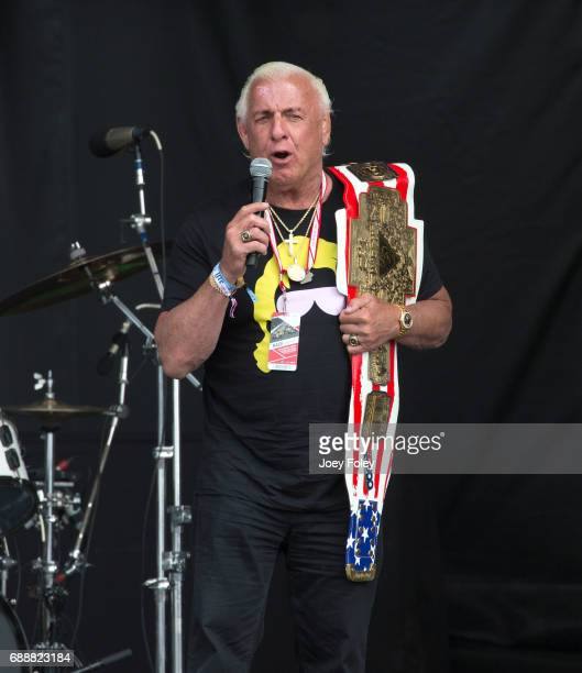 Retired professional wrestler Ric Flair announces the Steve Miller Band onstage at Indianapolis Motor Speedway on May 26 2017 in Indianapolis Indiana