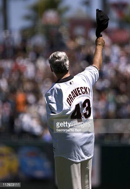 Retired San Francisco Giants pitcher Dave Dravecky waves to the crowd as he and other members of the 1987 Giants team are introduced before the...